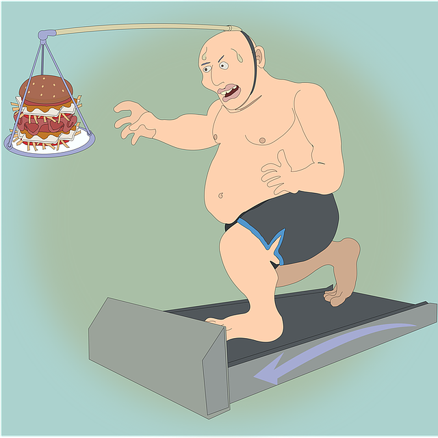 A man on a exercising on a treadmill with food in front of him